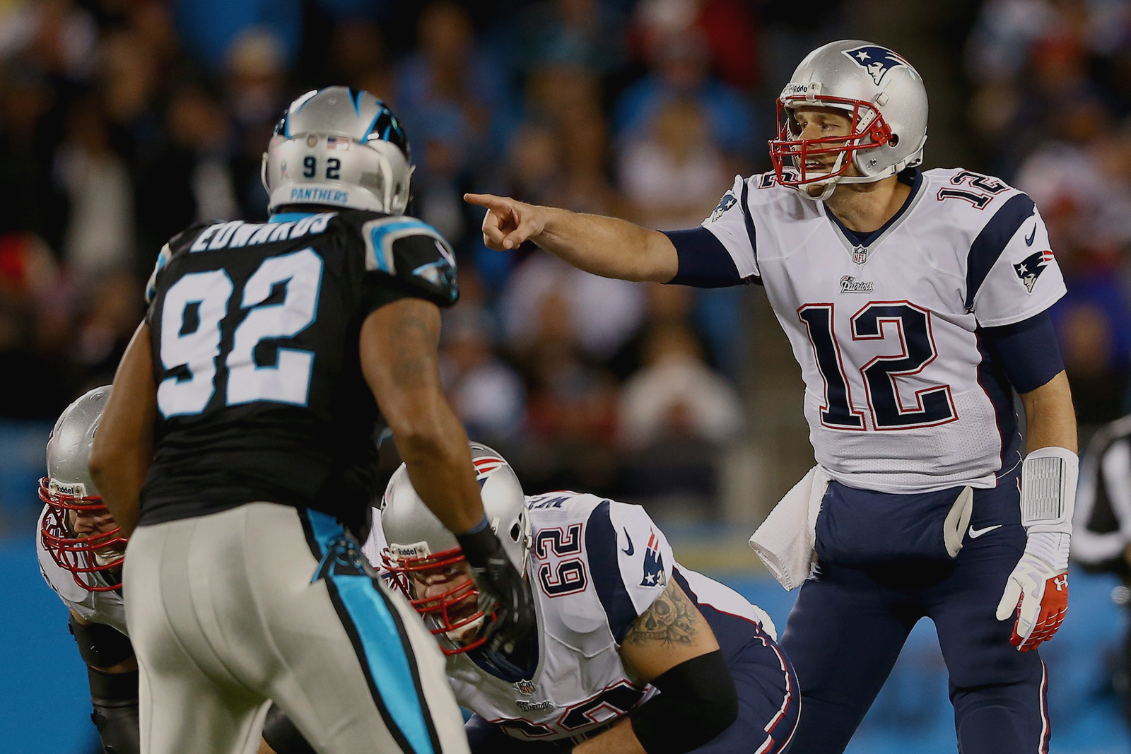 CHARLOTTE, NC - NOVEMBER 18:  Quarterback Tom Brady #12 of the New England Patriots calls out from under center in the first half against the Carolina Panthers at Bank of America Stadium on November 18, 2013 in Charlotte, North Carolina.  (Photo by Streeter Lecka/Getty Images)